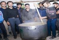 پخت و توزیع حلیم در روستای عزت الدین+ عکس